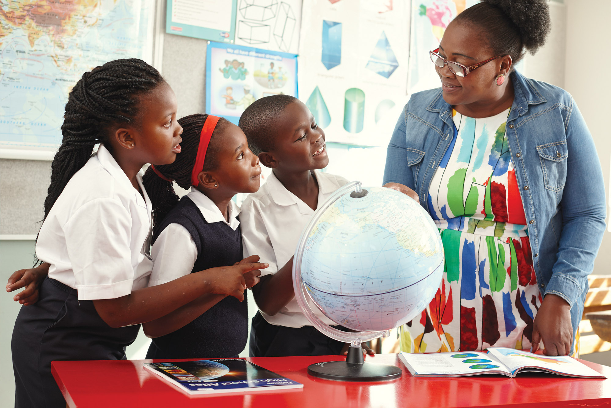 Teacher teaching children geography
